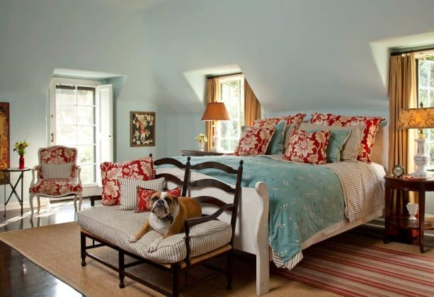 turquoise bed cover and red pillows