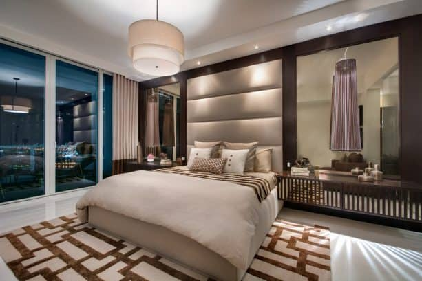 a contemporary bedroom with tan and dark brown color scheme