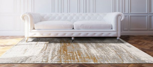 contemporary white, gold, and grey area rug in a luxurious living room
