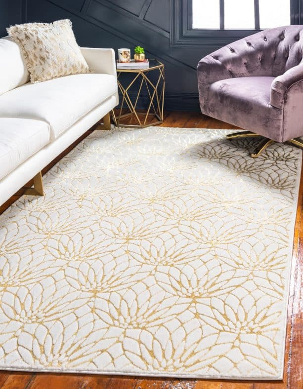 white and gold flower area rug in a living room