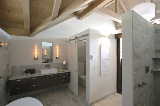 a sliding barn door for covering a small toilet in a contemporary bathroom