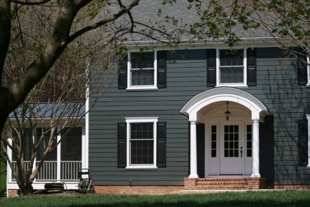 an elegant traditional exterior with dark gray, white, and black color scheme