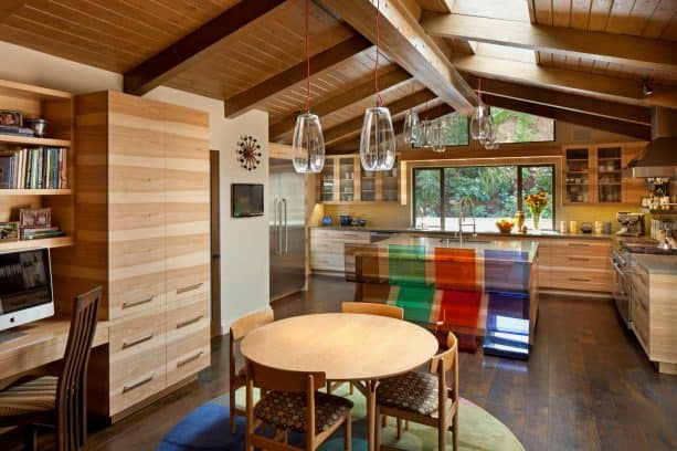 midcentury kitchen with the combination of hickory cabinetry and dark wood floor