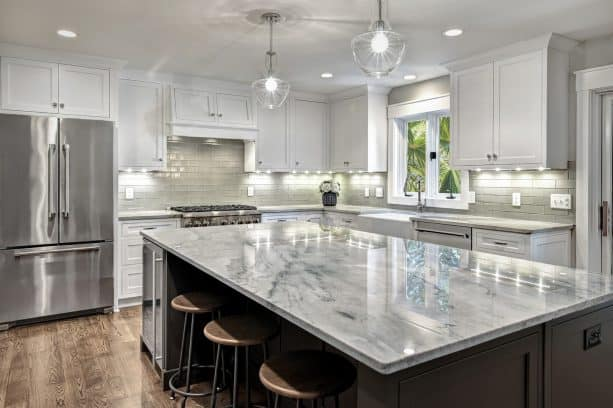 wall white shaker cabinets with lights under it