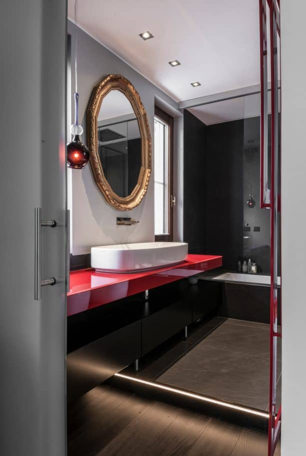 a bold contemporary red and black bathroom vanity with oversized white sink