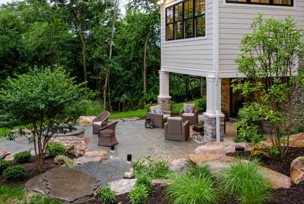 a traditional walkout basement patio that is focused more as an alternative seating area