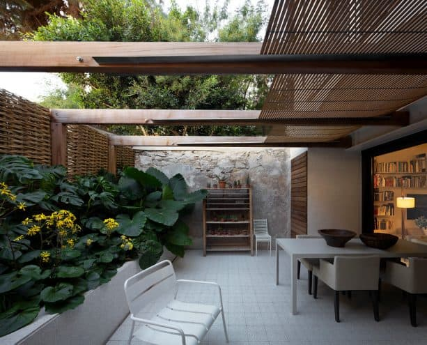 a trendy covered walkout basement patio of a small house