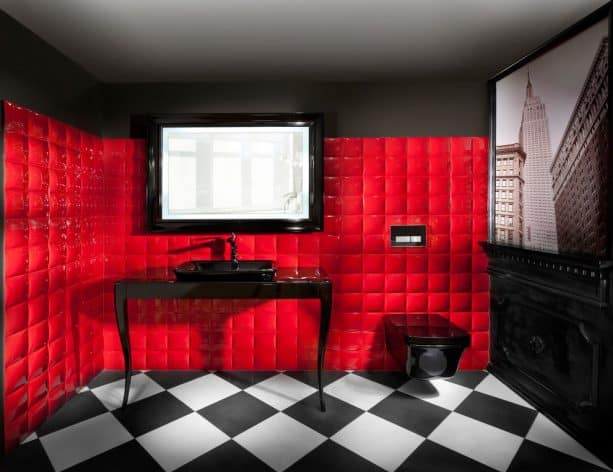 elegant red and black bathroom with unique red cushioned-like tiled wall