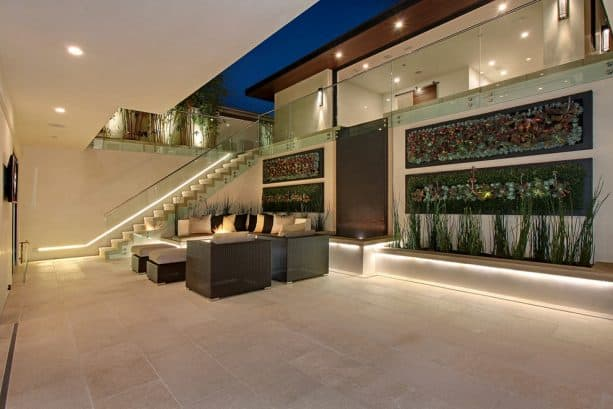 the seating area, water feature, and vertical garden in the walkout basement patio