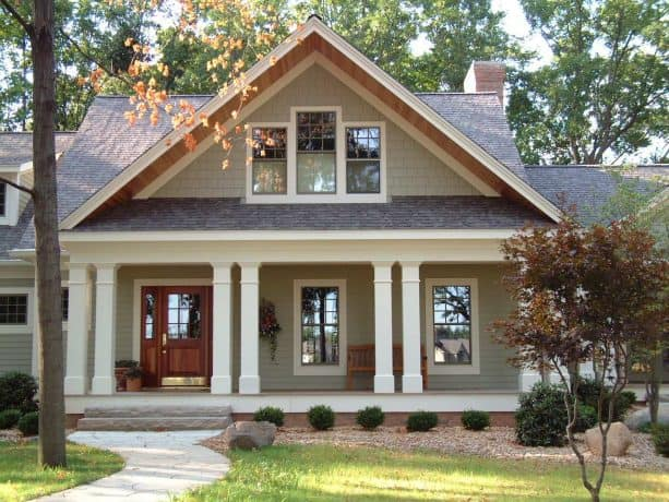 a greige craftsman house with brown roof shingles