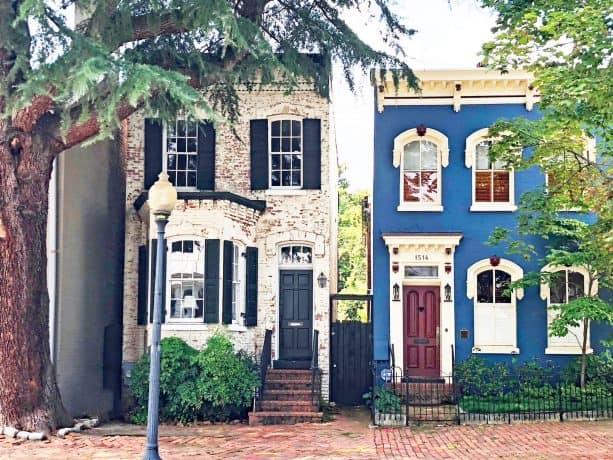 an elegant cobalt blue house with burgundy red front door