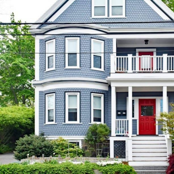 stone blue house with denim blue window trim and blood red doors
