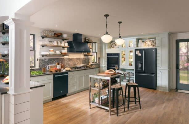 the use of complete black slate appliances, white cabinets, and black countertops in a modern kitchen