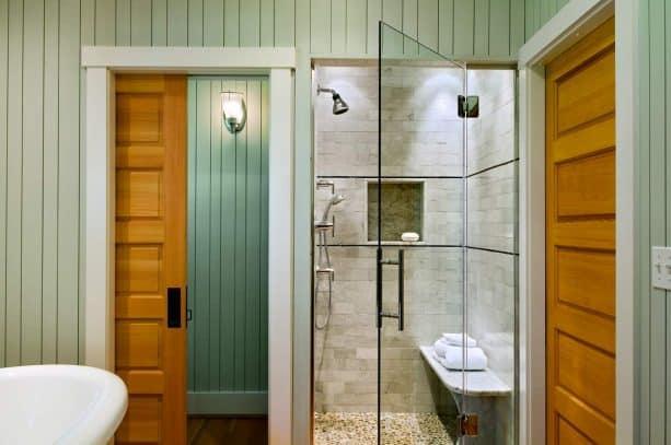 5-panel Douglas fir wood pocket door with white trim