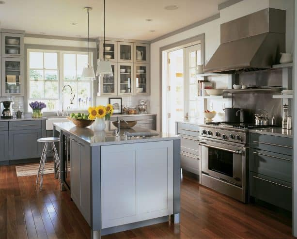 a contemporary kitchen interior with white walls, grey trim, white doors, and white windows