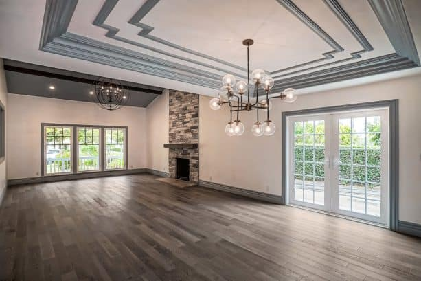 a midcentury interior with off-white walls, grey trim, and grey decorative gypsum for ceiling
