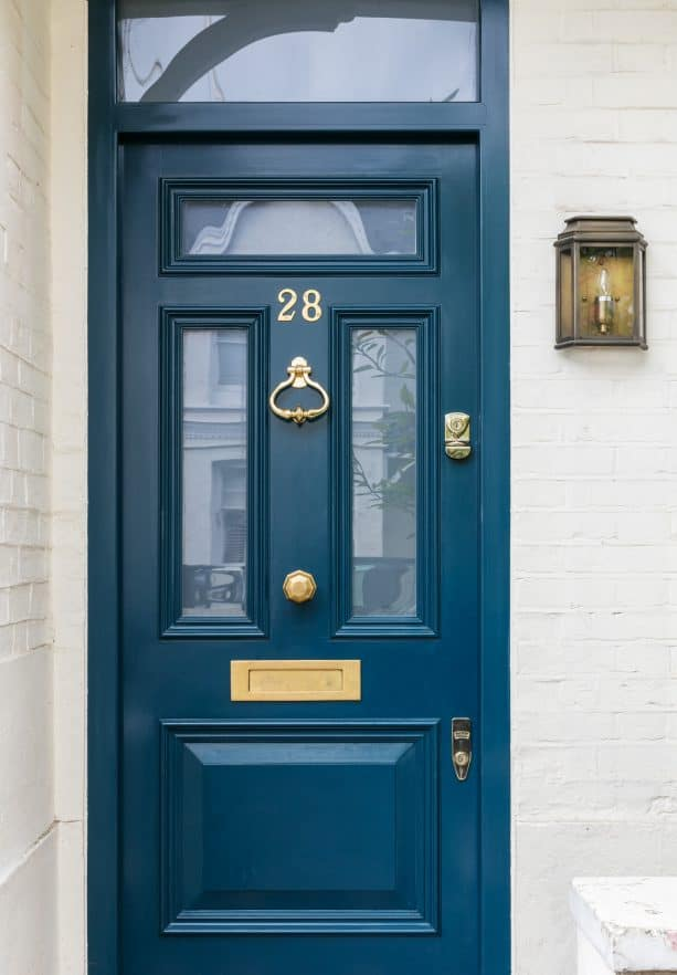 a transitional front door with Hague Blue paint
