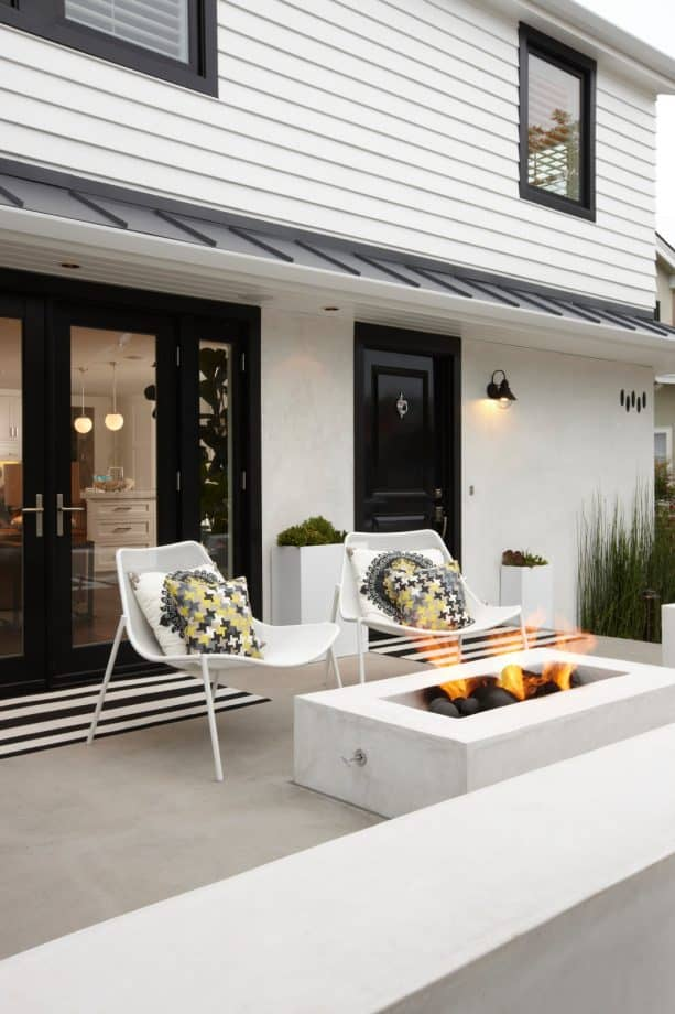 home exterior with white stucco material paired really nicely with black trim for the doors and windows
