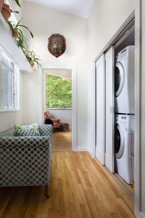 a laundry closet with pocket doors