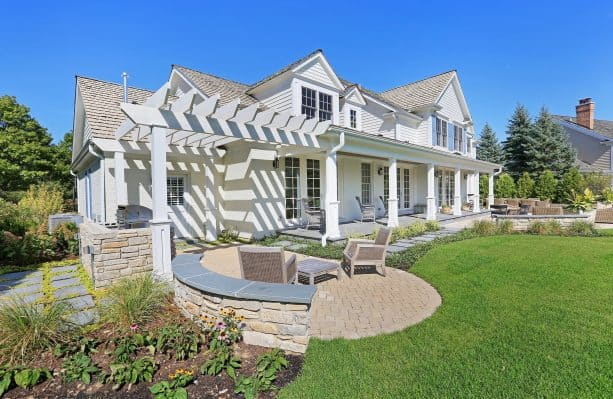 an elegant exterior with white siding and white brick combination
