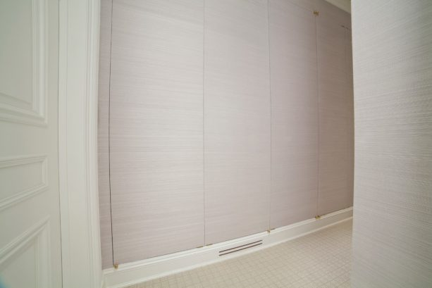 flat-panel laundry closet doors that look like a wall
