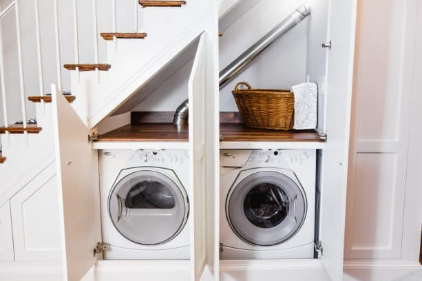 under-stair laundry closet with custom doors