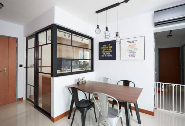 a small kitchen with black-framed door and interior windows