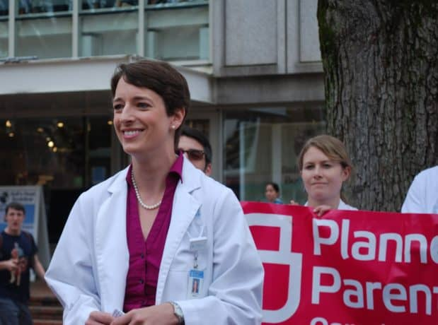 Michelle Brown speaking at a rally