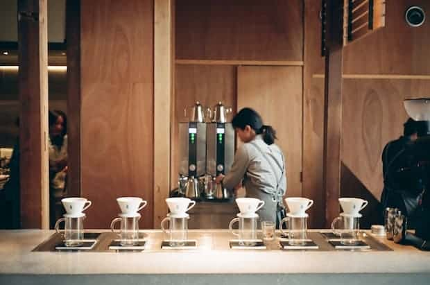 A barista behind the bar at Blue Bottle Coffee in Kyoto, Japan