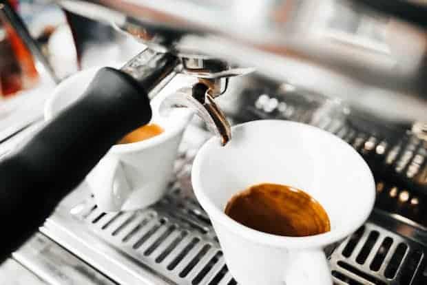 Two espresso shots brewing on the espresso machine