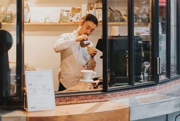 Japanese barista at a coffee takeout window