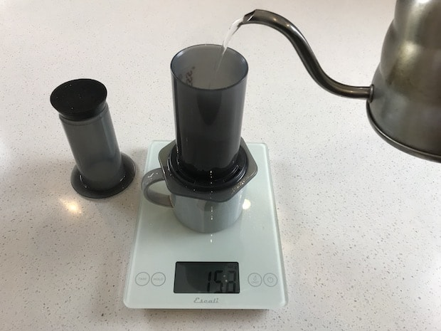 Pouring water into an AeroPress