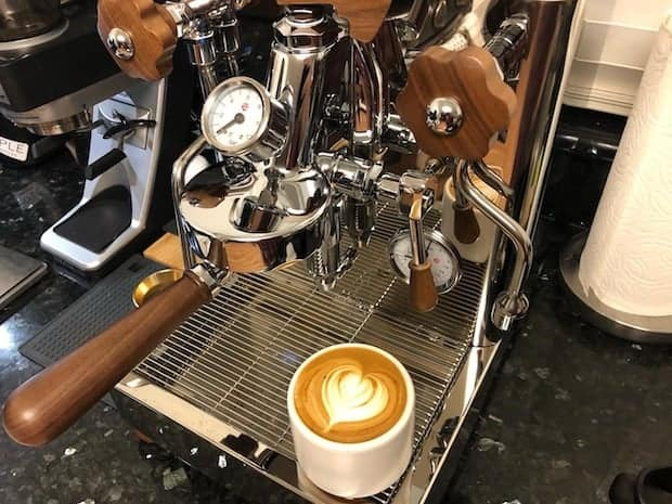 Lelit Bianca espresso machine with a freshly poured latte