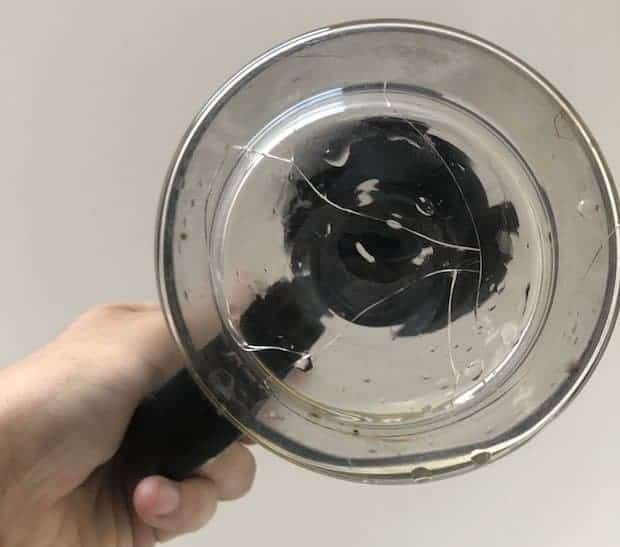 Bottom view of a cracked glass coffee pot