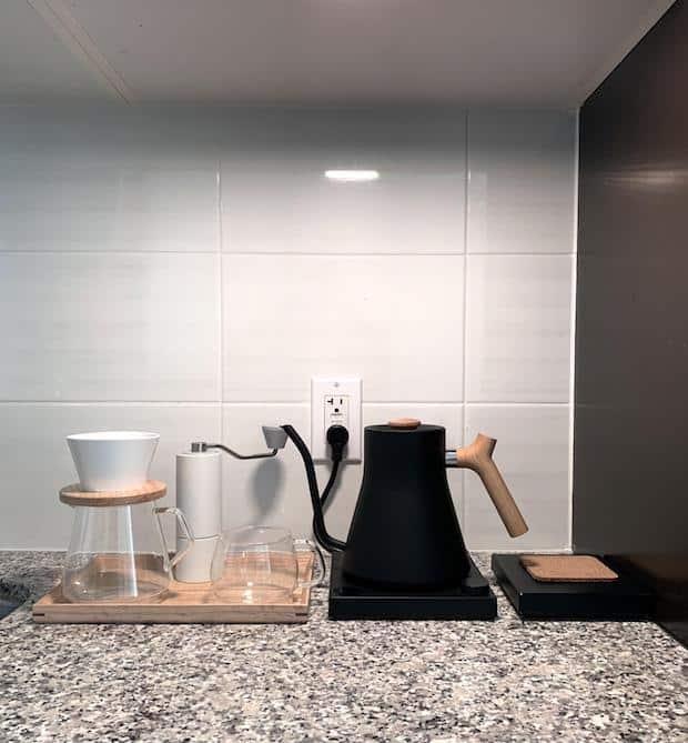 Minimalist coffee station on a kitchen counter