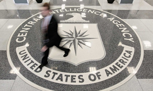 Photo of a blurred 'spook' walking through the entrance at CIA Headquarters Building in McLean, Virginia