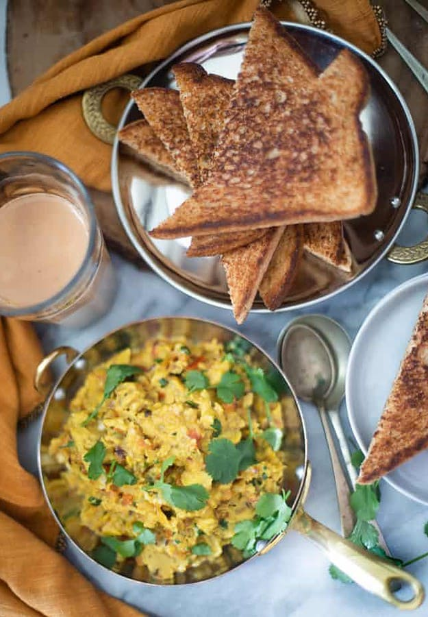 Indian style soft scrambled eggs cooked in spices  & served with toasted bread and chai