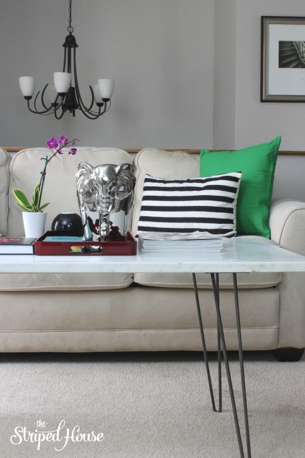 How to DIY a marble coffee table using a slab of Carrera marble and midcentury modern hairpin table legs.