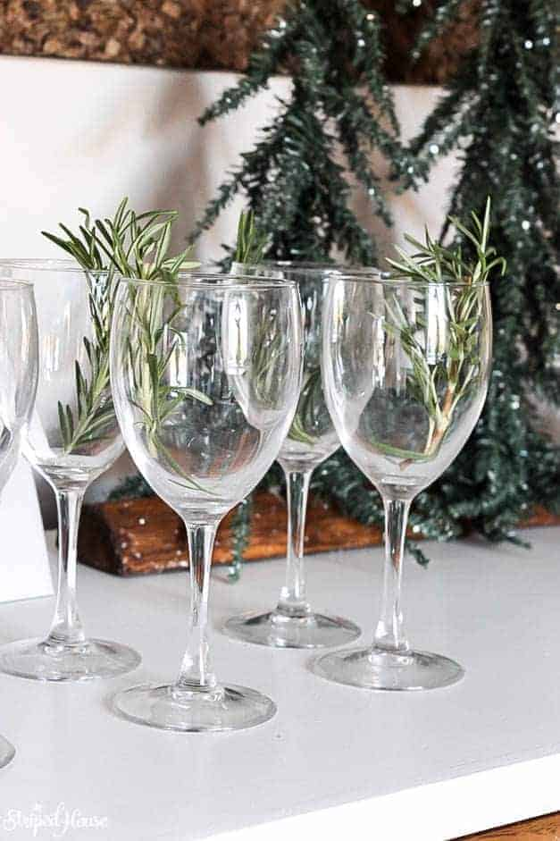 modern-traditional-scandinavian-christmas-home-tour-wine-glasses-with-rosemary