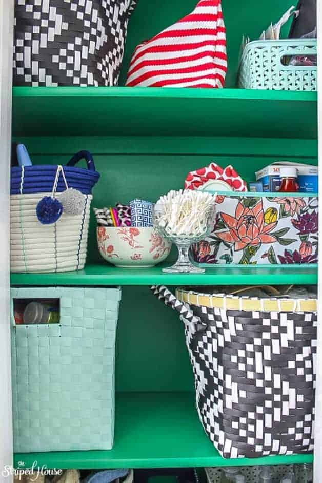 emerald green hall closet makeover with eclectic pretty storage