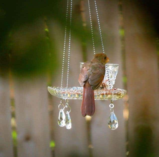 Pretty Yard Art and Garden ideas. These recycled teacup and crystal homemade bird feeders are beautiful!