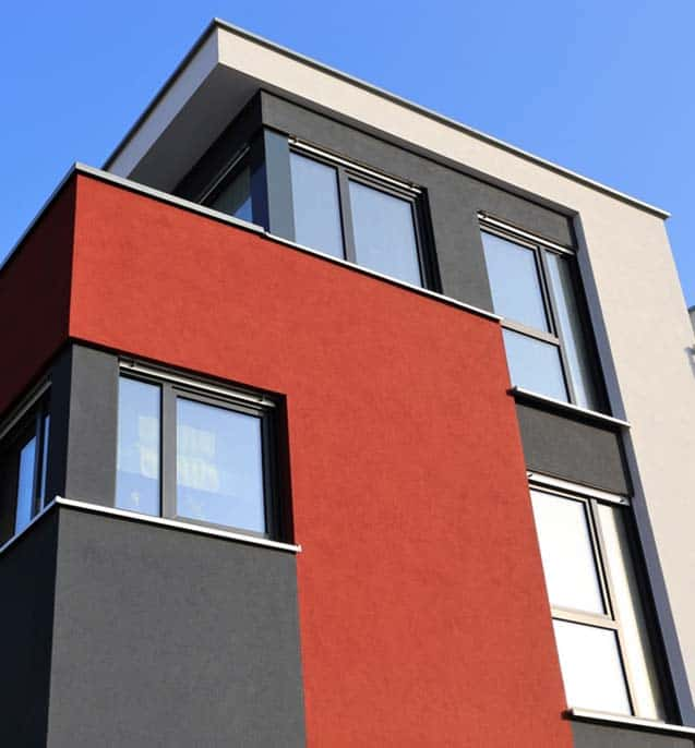 painted exterior of apartment building red and beige
