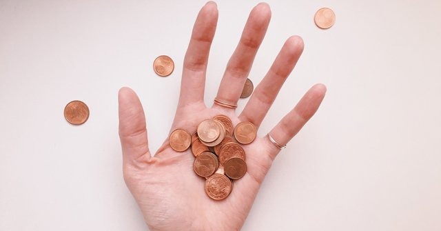 poor woman hand with coins