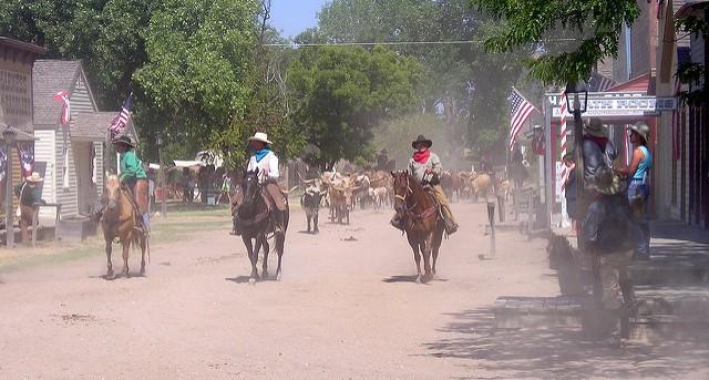Cowboys riding through the streets of the Old Cowtown Museum. Photo by Keith Wondra