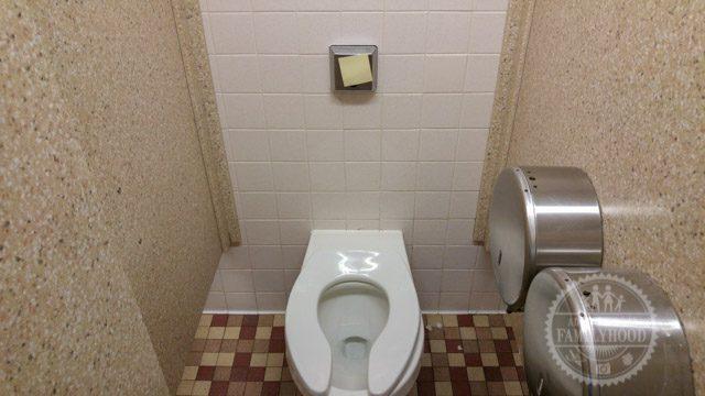 Life Hack Post-It over flush sensor at Disney World bathroom