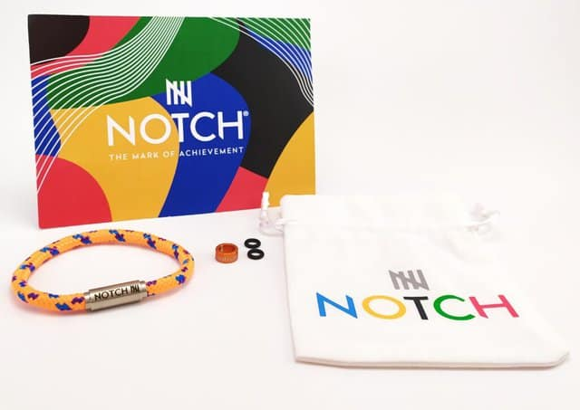 Image shows the contents of the NOTCH bracelet with gift bag.