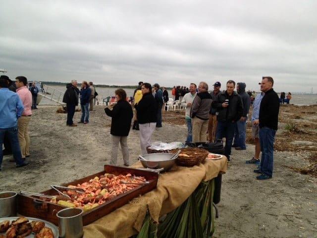 Enjoying Lowcountry boil on Morris Island. Party boat rental Charleston, SC