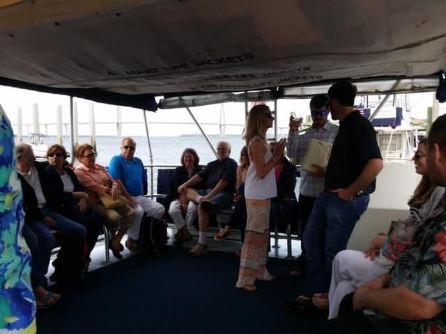 Group of people enjoying their time on a Sandlapper Tours boat. Boat charter Charleston SC