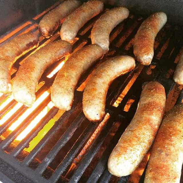 Summer cookout time! Smoking hot lovely bratwurst cooking on the gas grill