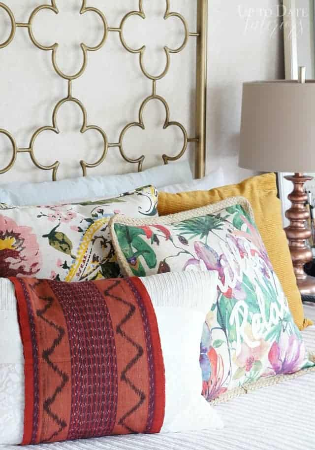 my home style is modern global eclectic with gold frame and mix and match pillows